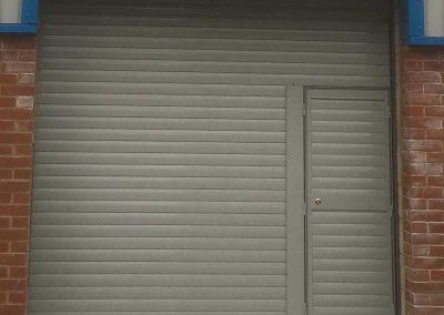 insulated roller shutter with wicket door