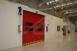 Instant roll vertical high speed doors